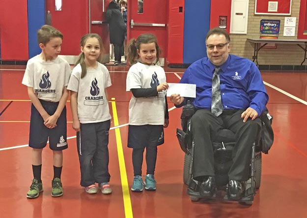 Robert Arciola, Sports Director & 6-year old students from St. Joan of Arc School in Lisles, IL who donated $500 to Paralyzed Veterans of America, Vaughan Chapter to fund the 39th National Veterans Wheelchair Games, in Louisville, Kentucky from July 11-July 16, 2019.